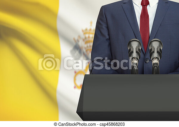 Businessman or politician making speech from behind a pulpit with national flag on background - Vatican City State - csp45868203