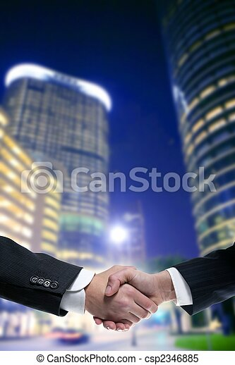 Businessman partners shaking hands with suit - csp2346885