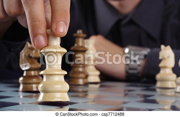 Businessman playing chess - csp7712488