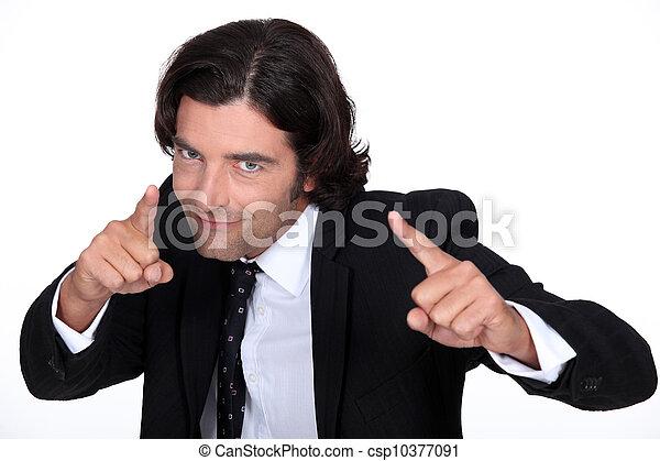 Businessman pointing - csp10377091