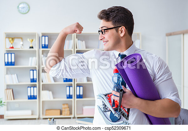 Businessman preparing to go exercising in gym - csp52309671