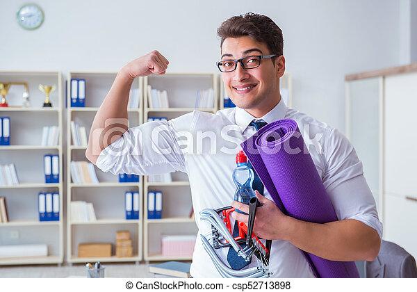 Businessman preparing to go exercising in gym - csp52713898