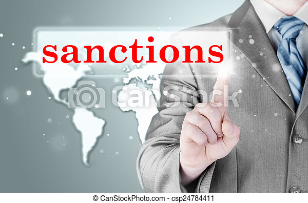 businessman pressing sanctions button on virtual screens - csp24784411