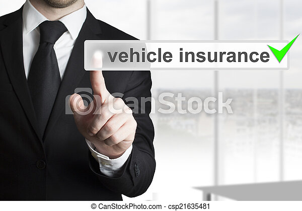 businessman pushing button vehicle insurance green check - csp21635481