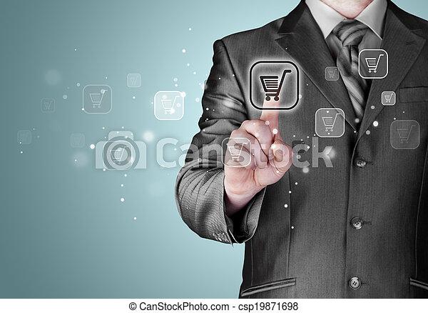 Businessman pushing shopping cart - csp19871698