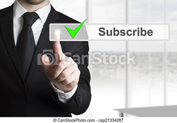 businessman pushing touchscreen button subscribe - csp21334287