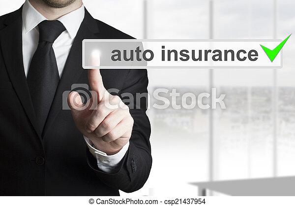 businessman pushing touchscreen button auto insurance - csp21437954