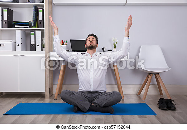 Businessman Raising His Arms In Office - csp57152044