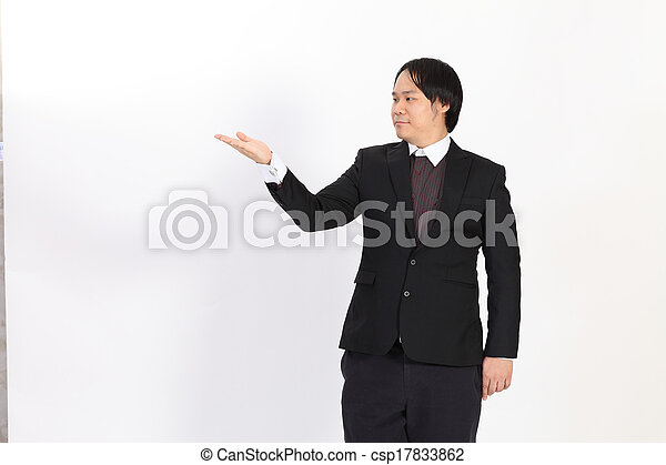 Businessman raising his hand - isolated over a white background - csp17833862