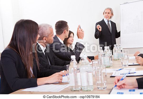 Businessman Raising His Hand - csp10979184
