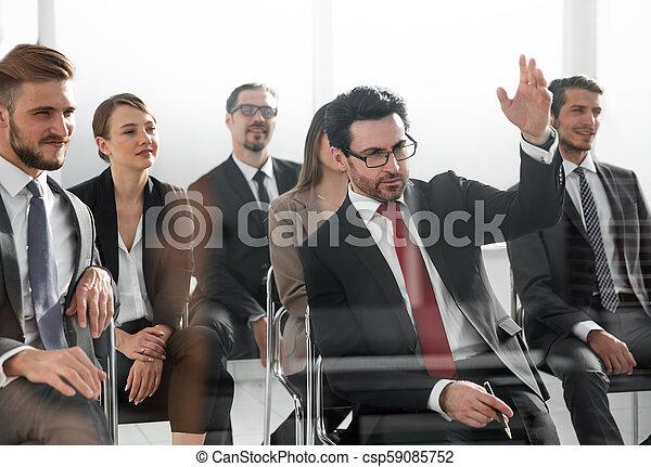 businessman raising his hand - csp59085752