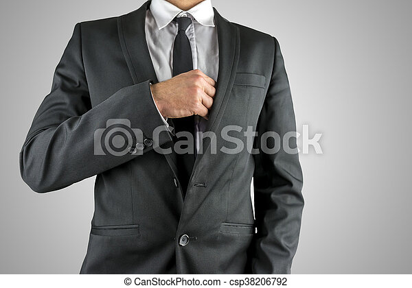 Businessman reaching inside his breast pocket - csp38206792