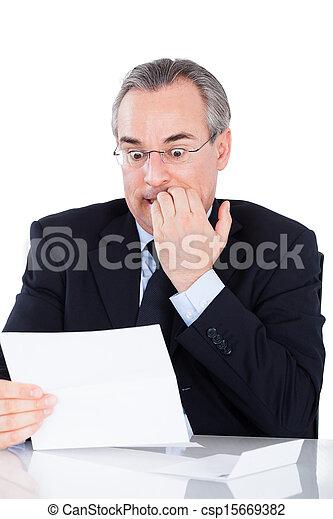 Businessman Reading Document - csp15669382