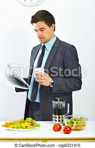 Businessman reading newspaper - csp6331410