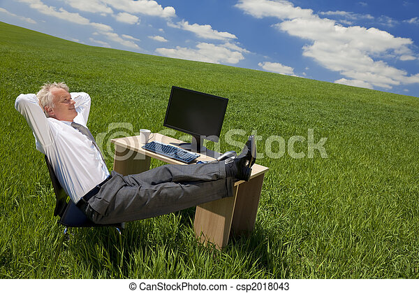 Businessman Relaxing In a Green Office - csp2018043