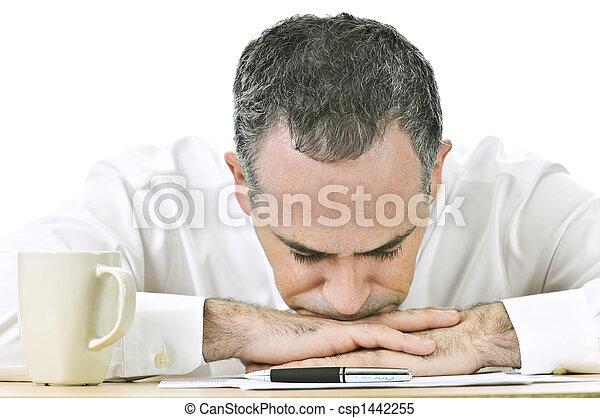 Businessman resting head on hands - csp1442255