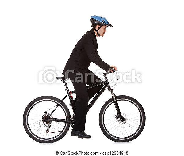 Businessman riding a bicycle - csp12384918