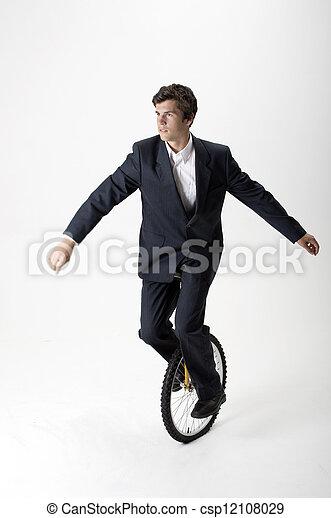 Businessman riding unicycle - csp12108029
