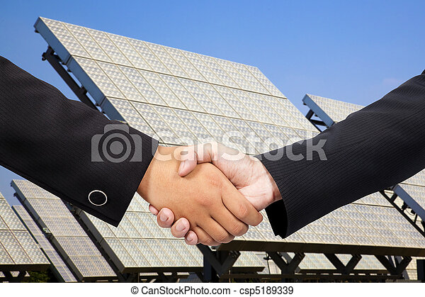 Businessman shaking hand before Solar power plant - csp5189339