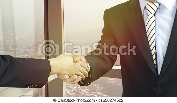 businessman shaking hand in office - csp50274522