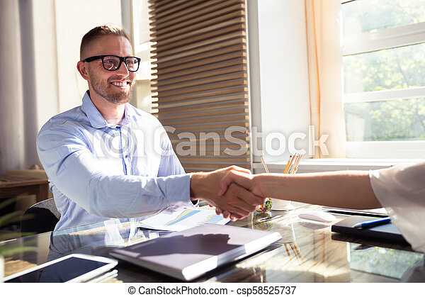 Businessman Shaking Hand With His Partner - csp58525737