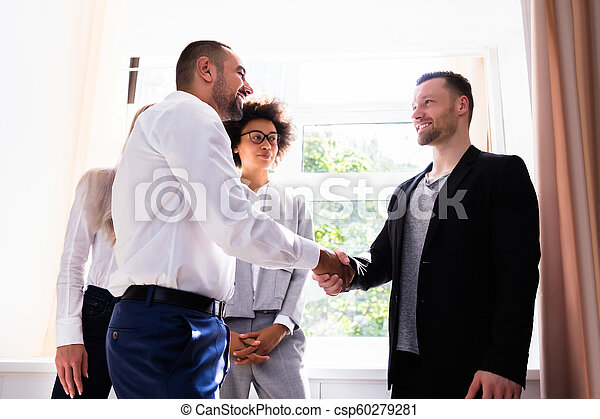 Businessman Shaking Hands With His Partner - csp60279281
