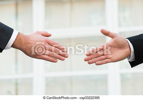 Businessman Shaking Hands With Partner - csp33222395