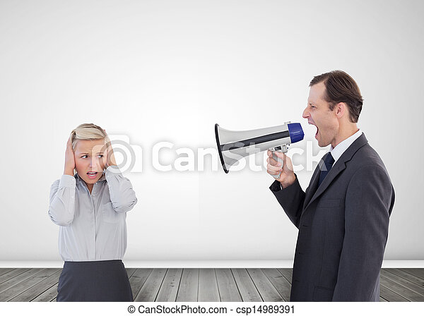 Businessman shouting with a megaphone at his colleague - csp14989391