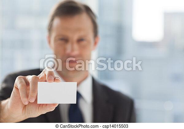 Businessman showing business card - csp14015503