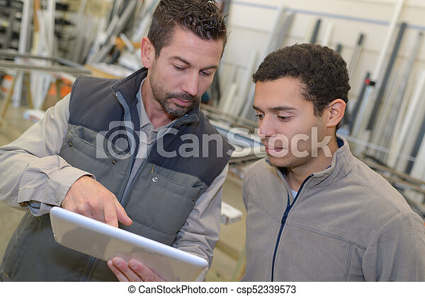 businessman showing digital tablet to co-worker - csp52339573