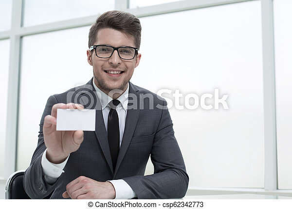 businessman showing his business card - csp62342773