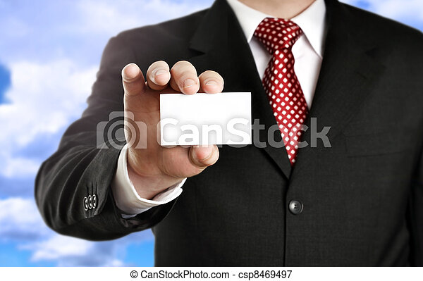 Businessman showing his business card, focus on fingers and card.  - csp8469497