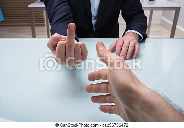 Businessman Showing Middle Finger To His Partner - csp56736472