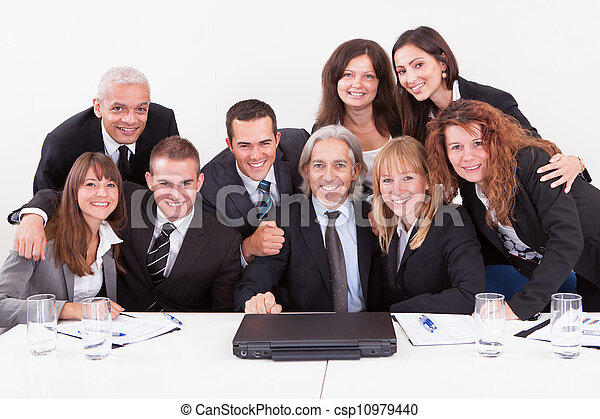 Businessman Showing On Laptop In Meeting - csp10979440