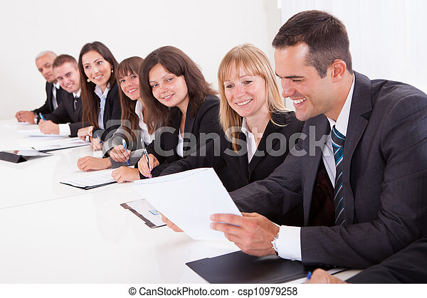 Businessman Showing Paper To His Colleagues - csp10979258