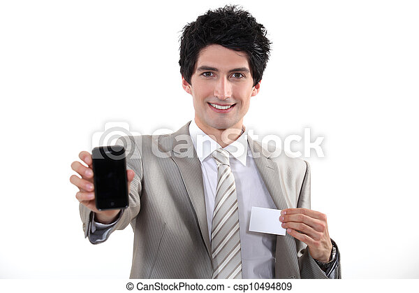 Businessman showing phone and business card - csp10494809