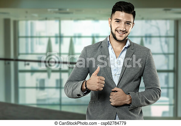 Businessman showing thumbs up sign - csp62784779