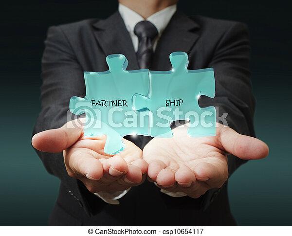 """businessman shows """"3d partnership"""" written puzzle pieces - csp10654117"""
