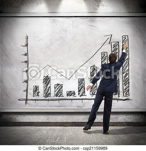 Businessman shows economic growth  - csp21159989