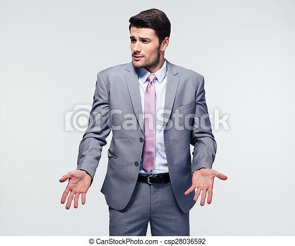 Businessman shrugging shoulders - csp28036592