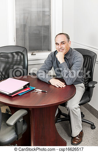 Businessman sitting in office meeting room - csp16626517