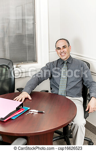 Businessman sitting in office meeting room - csp16626523