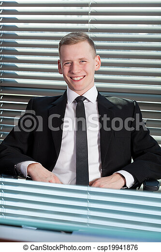 Businessman sitting in office - csp19941876