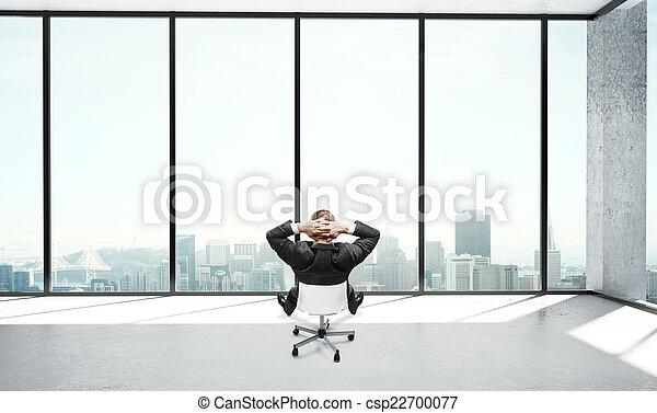 businessman sitting in office - csp22700077