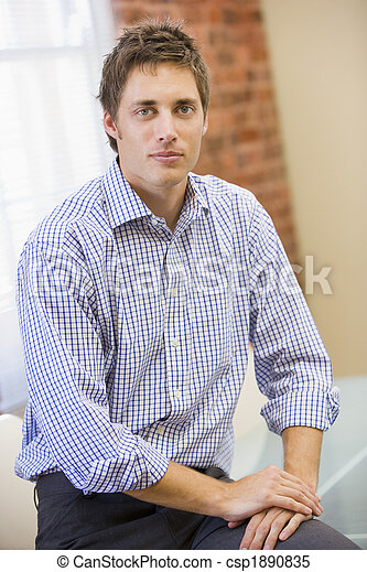 Businessman sitting in office - csp1890835