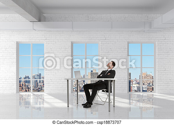 businessman sitting in room - csp18873707