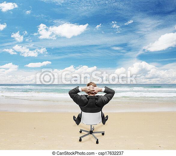 businessman sitting on beach - csp17632237