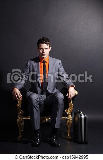 businessman sitting on chair - csp15942995