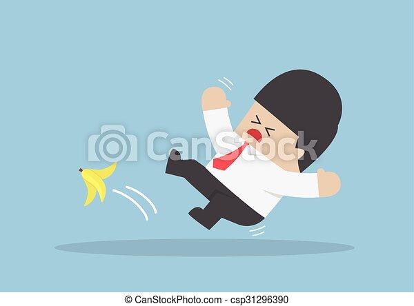 Businessman slipping on a banana peel - csp31296390
