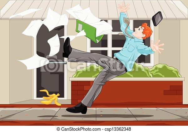 Businessman slipping on a banana skin - csp13362348